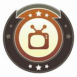 Television icon on imperial button