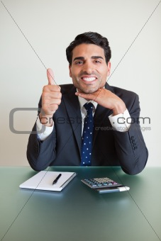 Portrait of an accountant with the thumb up