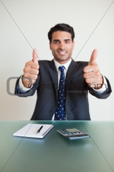 Portrait of a young accountant with the thumbs up
