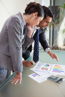 Portrait of young sales persons studying their results