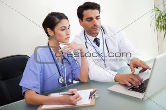 Young doctors working with a notebook