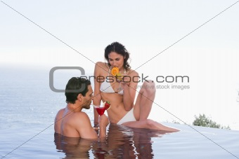 Charming couple having a cocktail