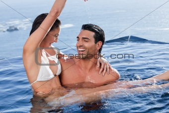 Man holding his playful girlfriend