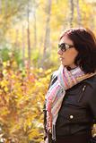 Attractive woman in sun glasses in autumn