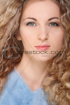 Portrait of the beauty young blond girl with curly hair