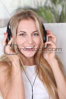 Blond beauty girl wearing headphones