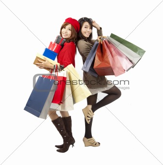 happy asian fashion girls holding shopping bag and gift box