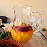 making a summer mix - jug with red wine, orange juice, ice and c