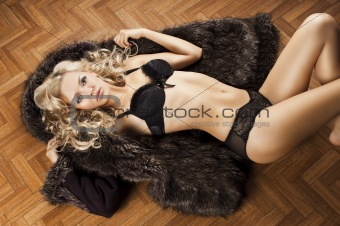 sexy girl in lingerie with fur, her arms are open