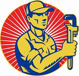 Plumber holding monkey wrench retro