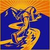 marathon runner running on road with mountains