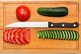 red tomato and green cucumbers