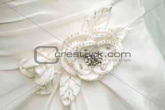 Brides dress flower detail.