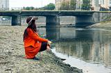 girl on the riverbank