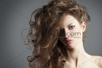 pretty girl with great hair style. she is in foregound