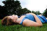 Beautiful girl laying down in park