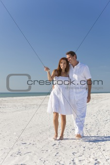 Romantic Man & Woman Couple Walking on An Empty Beach