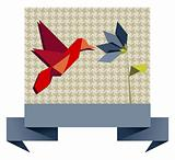 Single Origami hummingbird over textile pattern