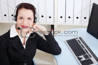 Beautiful business woman with headphones.