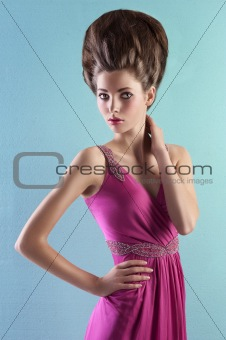 young woman in elegant pink dress and elegant up-do