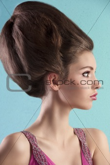 brunette with elegant up-do and pink dress
