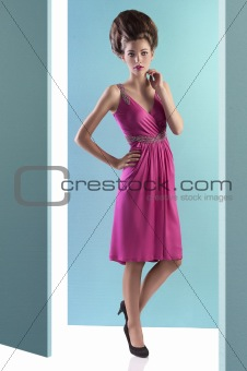 pretty young woman with fashion hairstyle and pink dress