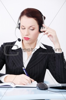 Beautiful business woman taking a note.