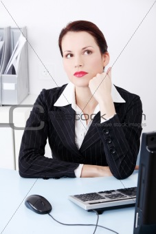 Beautiful business woman wondering in an office.