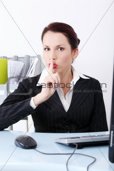 Beautiful business woman showing to be silent.