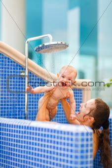 Mom playing with baby while taking shower