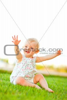 Lovely baby playing on grass
