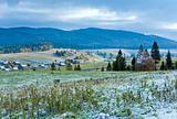 First winter snow and autumn mountain village