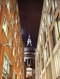 St Paul&#39;s cathedral through a street with business buildings