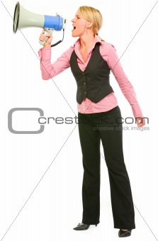 Modern business woman shouting through megaphone