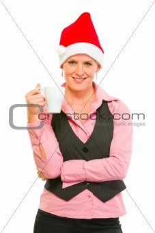 Happy modern business woman in Santa Hat with cup of coffee
