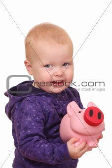Toddler with piggybank