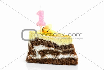 Slice of cream birthday cake with number one candle