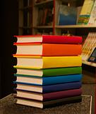 Pile of colorful books staying in the book shop
