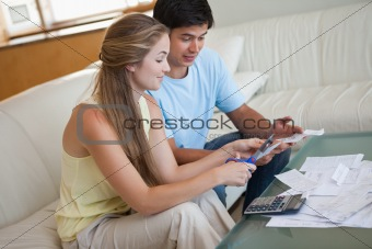 Couple cutting their credit card