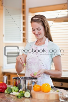 Portrait of a woman cooking