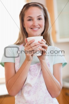 Portrait of a woman drinking a cup of coffee