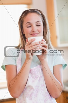 Portrait of a quiet woman drinking a cup of tea
