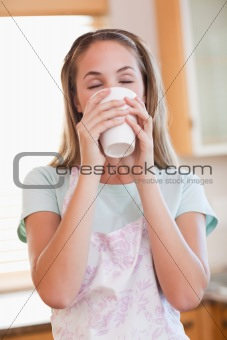 Portrait of a calm woman drinking a cup of tea