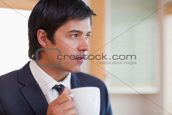 Close up of a handsome businessman drinking tea