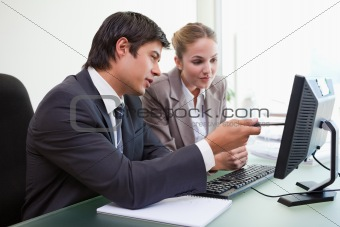 Focused business team working with a computer