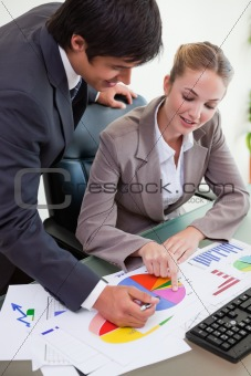 Portrait of a business team studying statistics