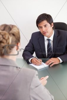 Portrait of a young manager interviewing a female applicant
