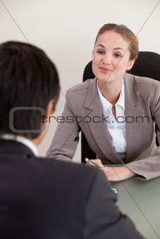 Portrait of a manager interviewing a male applicant