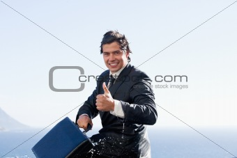 Cheerful businessman with the thumb up