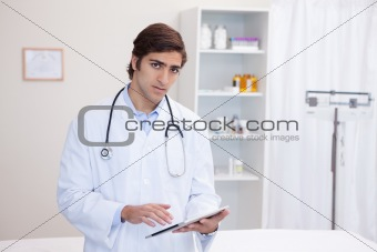 Male doctor using tablet